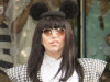 Lady Gaga heads out of her London hotel with mouse ears and a checked suit to greet her devoted fans